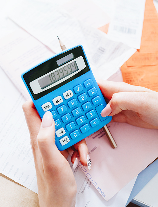lady with a calculator checking her business money